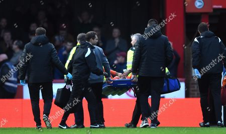 Stock Photo of Martin Olsson of Swansea City is treated before being stretchered from the field.