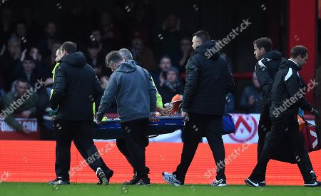 Stock Picture of Martin Olsson of Swansea City is treated before being stretchered from the field.