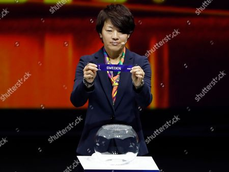 Aya Miyama holds up the team name of Sweden during the women's soccer World Cup France 2019 draw, in Boulogne-Billancourt, outside Paris