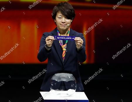 Aya Miyama holds up the team name of The Netherlands during the women's soccer World Cup France 2019 draw, in Boulogne-Billancourt, outside Paris