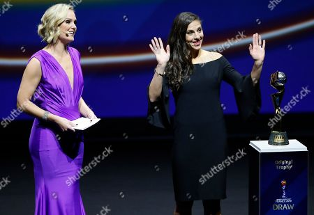 United States' Carli Lloyd, right, and Amanda Davies stand by the World Cup trophy during the women's soccer World Cup France 2019 draw, in Boulogne-Billancourt, outside Paris