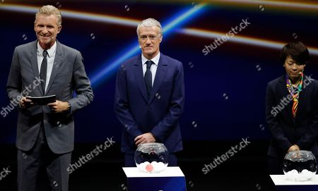 France coach Didier Dechamps, center, is flanked by host Denis Brogniart, left, and Japan's Aya Miyama, during the women's soccer World Cup France 2019 draw, in Boulogne-Billancourt, outside Paris