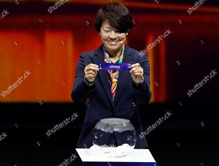 Aya Miyama holds up the team name of Japan during the women's soccer World Cup France 2019 draw, in Boulogne-Billancourt, outside Paris