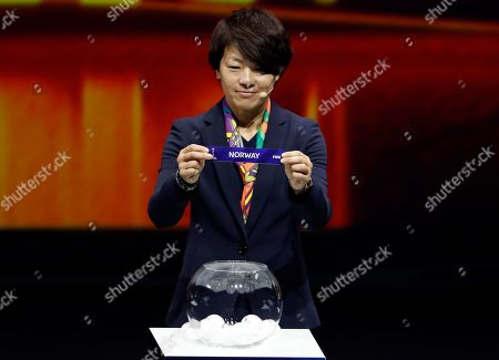 Aya Miyama holds up the team name of Norway during the women's soccer World Cup France 2019 draw, in Boulogne-Billancourt, outside Paris