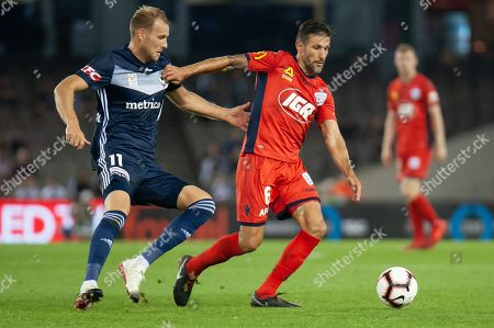 Melbourne Victory forward Ola Toivonen (11) competes with Adelaide United midfielder Vince Lia (6) at the Hyundai A-League Round 7 soccer match between Melbourne Victory v Adelaide United at Marvel Stadium in Melbourne, Australia.