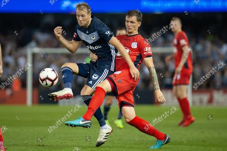 Melbourne Victory forward Ola Toivonen (11) is taken down at the Hyundai A-League Round 7 soccer match between Melbourne Victory v Adelaide United at Marvel Stadium in Melbourne, Australia.