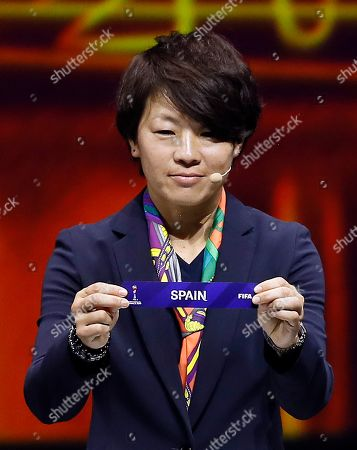Japanese soccer player Aya Miyama shows the lot of Spain during the draw ceremony for the FIFA Women's World Cup France 2019 in Paris, France, 08 December 2018. The FIFA Women's World Cup will take place from 07 June until 07 July 2019 in France.