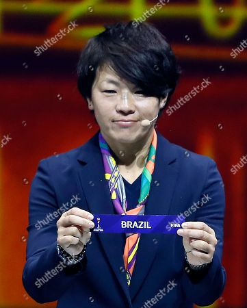 Stock Photo of Japanese soccer player Aya Miyama shows the lot of Brazil during the draw ceremony for the FIFA Women's World Cup France 2019 in Paris, France, 08 December 2018. The FIFA Women's World Cup will take place from 07 June until 07 July 2019 in France.