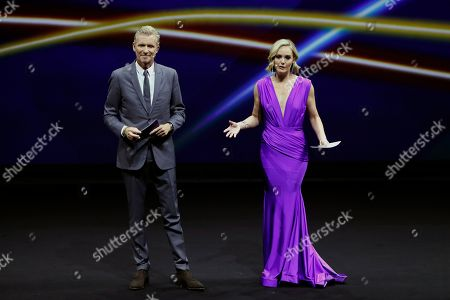 FIFA draw hosts Denis Brogniart (L) and Amanda Davies (R) during the draw ceremony for the FIFA Women's World Cup France 2019 in Paris, France, 08 December 2018. The FIFA Women's World Cup will take place from 07 June until 07 July 2019 in France.