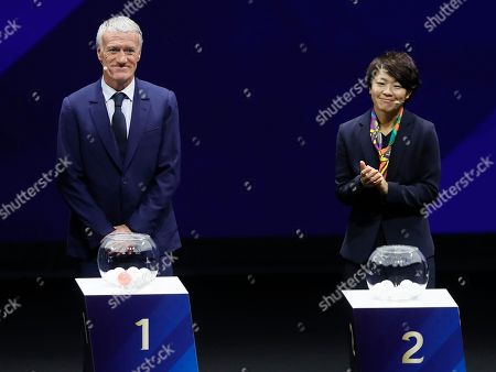 France's national soccer team head coach Didier Deschamps (L) and Japanese soccer player Aya Miyama (R)  during the draw ceremony for the FIFA Women's World Cup France 2019 in Paris, France, 08 December 2018. The FIFA Women's World Cup will take place from 07 June until 07 July 2019 in France.