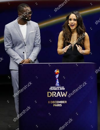 French former footballer Louis Saha (L) and  English former footballer Alex Scott (R) during the draw ceremony for the FIFA Women's World Cup France 2019 in Paris, France, 08 December 2018. The FIFA Women's World Cup will take place from 07 June until 07 July 2019 in France.
