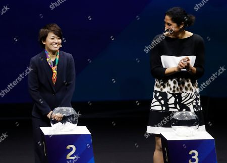 Japanese soccer player Aya Miyama (L) and German former head coach of the women's national team, Steffi Jones (R) during the draw ceremony for the FIFA Women's World Cup France 2019 in Paris, France, 08 December 2018. The FIFA Women's World Cup will take place from 07 June until 07 July 2019 in France.