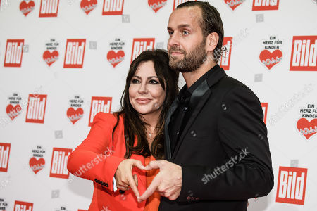 German actress Simone Thomalla (L) and her partner the keeper of the German National Handball team Silvio Heinevetter arrive for the charity gala Ein Herz fuer Kinder (A Heart for Children) in Berlin, Germany, 08 December 2018. German television channel ZDF and newspaper 'Bild' collected donations for children's charity organizations in Germany and the whole world.
