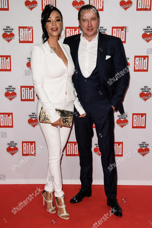 German business woman Verona Pooth (L) and her husband Franjo Pooth arrive for the charity gala Ein Herz fuer Kinder (A Heart for Children) in Berlin, Germany, 08 December 2018. German television channel ZDF and newspaper 'Bild' collected donations for children's charity organizations in Germany and the whole world.