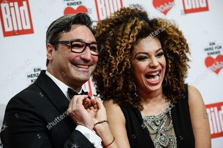 Stock Picture of German music producer Mousse T. (L) and his partner  TV presenter Khadra Sufi arrive for the charity gala Ein Herz fuer Kinder (A Heart for Children) in Berlin, Germany, 08 December 2018. German television channel ZDF and newspaper 'Bild' collected donations for children's charity organizations in Germany and the whole world.