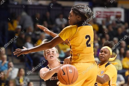 Notre Dame guard Marina Mabrey, left, passes against Toledo guard Mikaela Boyd (2) and forward Sarah St-Fort (5) during the second half of an NCAA college basketball game, in Toledo, Ohio