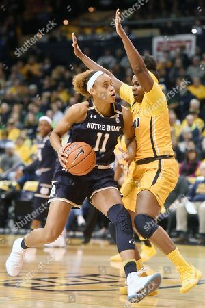 Stock Image of Notre Dame forward Brianna Turner (11) drives against Toledo forward Sarah St-Fort (5) during the first half of an NCAA college basketball game, in Toledo, Ohio