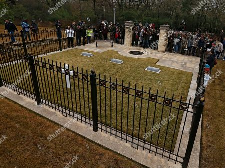 Visitors take pictures and look at the gravesite of former US President George H.W. Bush (C) his wife Barbara Bush (L) and their daughter Robin (R) at the Presidential Library and Museum in College Station, Texas, USA, 08 December 2018. Bush died at the age of 94 on 30 November 2018 at his home in Texas. George H.W. Bush was the 41st President of the United States (1989-1993).