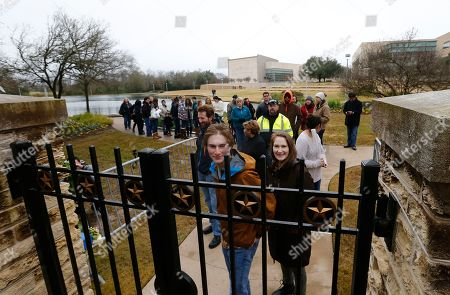 People wait in line outside the gate waiting to get in to have a look at the gravesite of former US President George H.W. Bush, his wife Barbara Bush and their daughter Robin at the Presidential Library and Museum in College Station, Texas, USA, 08 December 2018. Bush died at the age of 94 on 30 November 2018 at his home in Texas. George H.W. Bush was the 41st President of the United States (1989-1993).