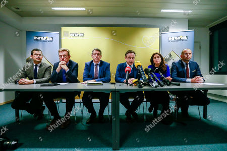 Stock Image of (L-R) Sander Loones is the Belgian Minister of Defence, Belgian Finance Minister Johan Van Overtveldt,  Belgian Interior Minister Jan Jambon, Bart De Wever, New Flemish Alliance (Nieuw-Vlaamse Alliantie, N-VA) party leader, Belgium State Secretary for Poverty and Equal opportunities Zuhal Demir and Belgian Secretary of State for Asylum, Migration, member of NVA Party Theo Francken give a press conference after the NVA left the negotiation during a Minister Council in Brussels, Belgium, 08 December 2018. The NVA threatens to leave the Belgian government if Prime Minister Charles Michel goes to Marrakesh to defend the UN migration pact.