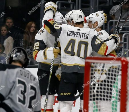 Vegas Golden Knights center Oscar Lindberg, right, of Sweden, celebrates scoring against Los Angeles Kings goaltender Jonathan Quick, left, with defenseman Nick Holden (22) and center Ryan Carpenter (40) during the first period of an NHL hockey game in Los Angeles