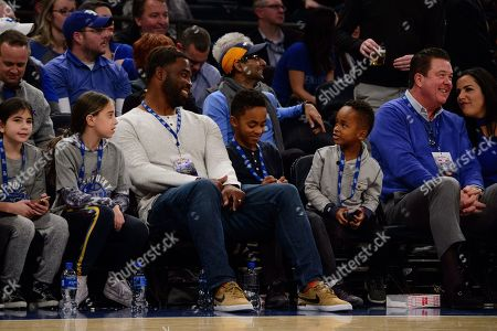 Former NFL player Justin Tuck looks on with his family during The Citi Hoops Classic between The Seton Hall Pirates and Kentucky Wildcats at Madison Square Garden, New York, New York. The Seton Hall Pirates defeat The Kentucky Wildcats 84-83 in overtime. Mandatory credit: Kostas Lymperopoulos/CSM