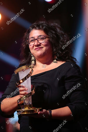 Winner of the grand jury prize, Sudabeh Mortezai, for her film Joy, poses with her award during the final day of the 17th Marrakech International Film Festival, in Marrakech, Morocco, Saturday, Dec.8, 2018
