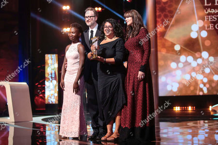Winner of the grand jury prize, Sudabeh Mortezai, center, for her film Joy, poses with Monica Bellucci and James Gray, during the final day of the 17th Marrakech International Film Festival, in Marrakech, Morocco, Saturday, Dec.8, 2018