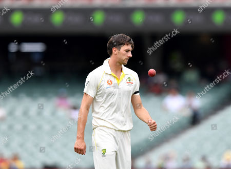 Patrick Cummins of Australia looks on during day four of the first Test Match between Australia and India at the Adelaide Oval in Adelaide, Australia, 09 December 2018.