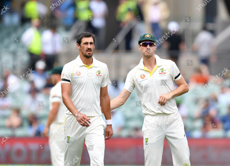 Mitchell Starc (L) and Patrick Cummins (R) of Australia look on during day four of the first Test Match between Australia and India at the Adelaide Oval in Adelaide, Australia, 09 December 2018.