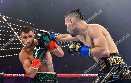 Vasyl Lomachenko moves away from punch from Jose Pedraza in the WBO lightweight title boxing match at Madison Square Garden, in New York
