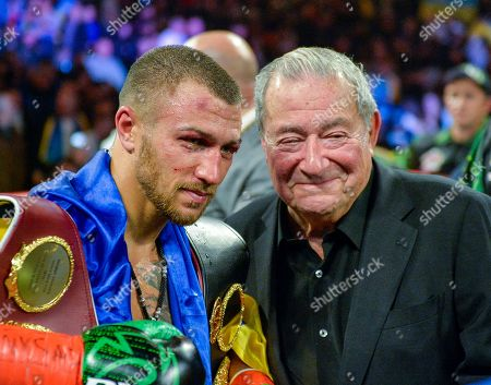 Vasyl Lomachenko poses with promoter Bob Arum after defeating Jose Pedraza in the WBO title lightweight boxing match at Madison Square Garden, in New York