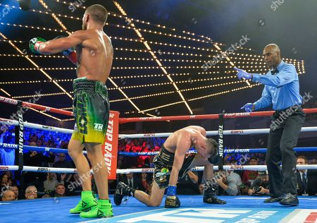 Vasyl Lomachenko heads to a neutral corner after a second knockdown of Jose Pedraza in the 11th round of the WBO title lightweight boxing match at Madison Square Garden, in New York