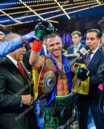Vasyl Lomachenko smiles after defeating Jose Pedraza in a WBO title lightweight boxing match at Madison Square Garden, in New York