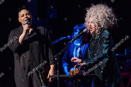 "Sara Ramirez, Cyndi Lauper. Sara Ramirez, left, and Cyndi Lauper performs at the 8th Annual ""Home for the Holidays"" benefit concert at the Beacon Theatre, in New York"