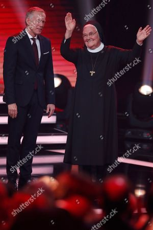 Stock Photo of Sister Klara and Johannes B. Kerner during the Ein Herz Fuer Kinder Gala show in Berlin, Germany, 08 December 2018. German television channel ZDF and newspaper 'Bild' collected donations for children's charity organizations in Germany and the whole world.