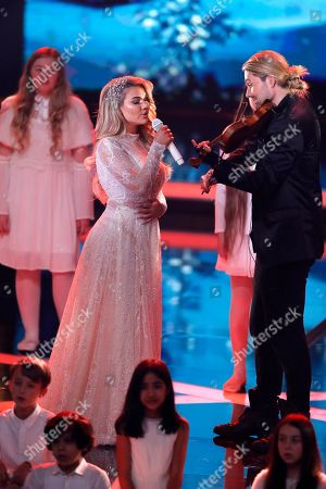Shirin David and David Garrett perform at the Ein Herz Fuer Kinder Gala show in Berlin, Germany, 08 December 2018. German television channel ZDF and newspaper 'Bild' collected donations for children's charity organizations in Germany and the whole world.