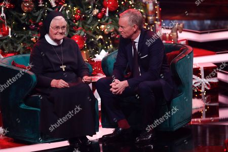 Sister Klara and Johannes B. Kerner during the Ein Herz Fuer Kinder Gala show in Berlin, Germany, 08 December 2018. German television channel ZDF and newspaper 'Bild' collected donations for children's charity organizations in Germany and the whole world.
