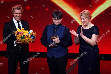 Stock Picture of Sascha Grammel, Colin Rimbach and Franziska Giffey during the Ein Herz Fuer Kinder Gala show in Berlin, Germany, 08 December 2018. German television channel ZDF and newspaper 'Bild' collected donations for children's charity organizations in Germany and the whole world.