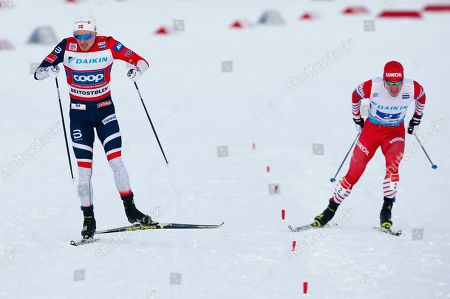 Norway's Finn-Hagen Krogh (L) and Andrey Melnichenko of Russia compete in the men's Cross Country Skiing Relay Classic/Free event at the FIS Nordic Skiing World Cup in Beitostolen, Norway, 09 December 2018.