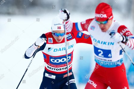Left Finn-Hagen Krogh (L) of Norway and Andrey Melnichenko of Russia compete in the men's Cross Country Skiing Relay Classic/Free event at the FIS Nordic Skiing World Cup in Beitostolen, Norway, 09 December 2018.