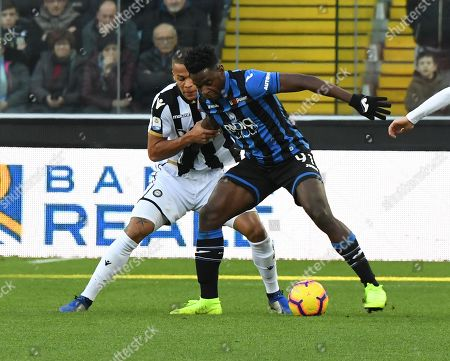 Udinese's William Troost-Ekong and Atalanta's Duvan Zapata (R) in action during the Italian Serie A soccer match Udinese vs Atalanta at Friuli stadium in Udine, Italy, 09 December 2018.