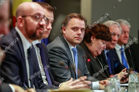 Philippe De Backer (Open Vld) (C), minister of  the fight against social fraud and the North Sea, Digital Agenda, Telecoms and Post Office and Administrative Simplification at a press conference after a Minister Council in Brussels, Belgium, 09 December 2018. Earlier in the day New Flemish Alliance (Nieuw-Vlaamse Alliantie, N-VA) party left the government after Prime Minister Charles Michel announced he will go to Marrakesh to defend the UN migration pact. N-VA will no longer be part of the government. According to reports, Michel has reshuffled his cabinet to replace three ministers from the N-VA who have resigned.