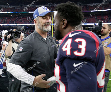 Stock Photo of Indianapolis Colts coach Frank Reich, left, shakes hands with Houston Texans defensive back Shareece Wright (43) after an NFL football game, in Houston. The Colts won 24-21