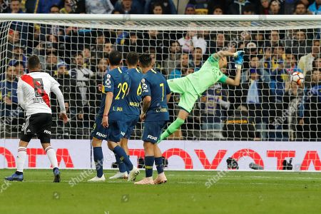 Stock Picture of River Plates' player Juan Fernando Quintero (L) scores a goal during the extra time of the Libertadores Cup´s final second leg game at the Santiago Bernabeu Stadium in Madrid, Spain, 09 December 2018. River Plate won 5-3 on aggregate.