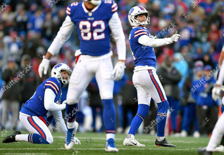 Buffalo Bills kicker Stephen Hauschka, right, follows through on a field goal against the New York Jets during the second half of an NFL football game, in Orchard Park, N.Y