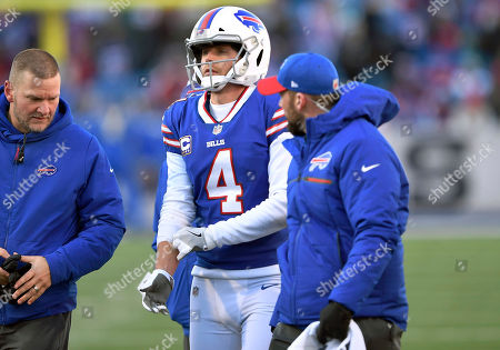 Buffalo Bills kicker Stephen Hauschka (4) is assisted from the field after an injury during the first half of an NFL football game against the New York Jets, in Orchard Park, N.Y