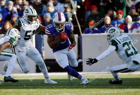 Buffalo Bills running back Chris Ivory (33) runs against the New York Jets during the first half of an NFL football game, in Orchard Park, N.Y