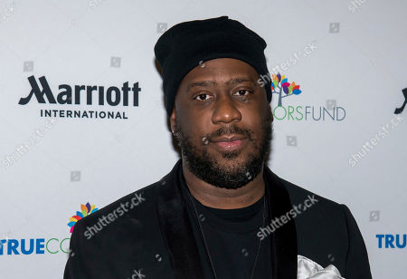 "Robert Glasper posses backstage at Cyndi Lauper's 8th Annual ""Home for the Holidays"" benefit concert at the Beacon Theatre, in New York"