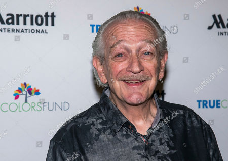 """Stock Image of Charlie Musselwhite posses backstage at Cyndi Lauper's 8th Annual """"Home for the Holidays"""" benefit concert at the Beacon Theatre, in New York"""